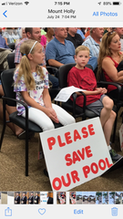 Lumberton resident Angela Bonsignore  and her children Madeline and Nicholas protest at a recent Burlington County Board of Freeholders meeting against a  decision by Rowan College at Burlington County to close its indoor swimming pool by Aug. 4 .The family's  daughters swim for the Burlington County Aqua Barons team.
