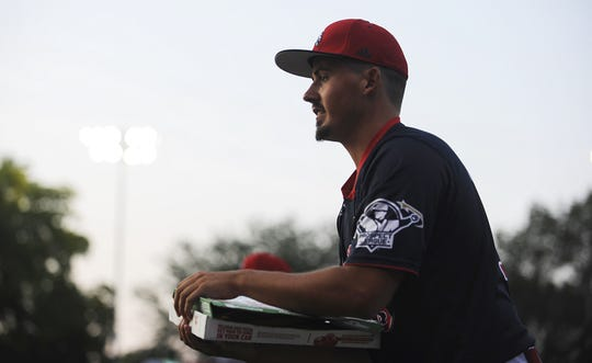 Paints pitcher Nate Haugh does the pizza box challenge with a young fan between innings of a game against West Virginia on Aug. 1, 2019 at VA Memorial Stadium. Haugh did not receive any offers out of high school but now he has found success at Toledo and is the top reliever in the Prospect League this summer.