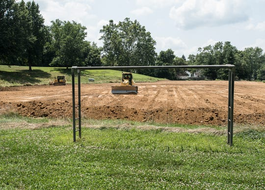 Bulldozers flatten the land that Allen Elementary once occupied as a set of monkey bars still stands as one of the few lasting remnants of the school's existence. An auction was held on August 2, 2019, to sell off parts of the land the school once resided on.