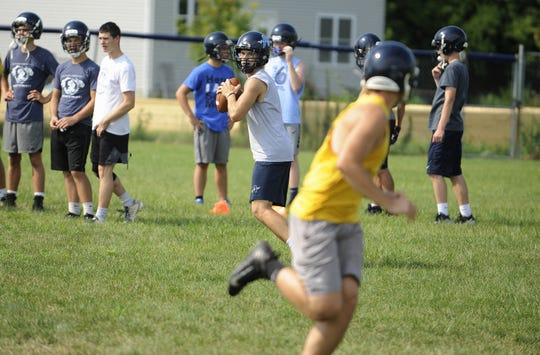 Adena quarterback Preston Sykes practices on the first day of two-a-days in Frankfort, Ohio on Aug. 1, 2019.
