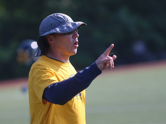 Moeller head coach Todd Naumann gives instruction during practice, Thursday, Aug 1, 2019.