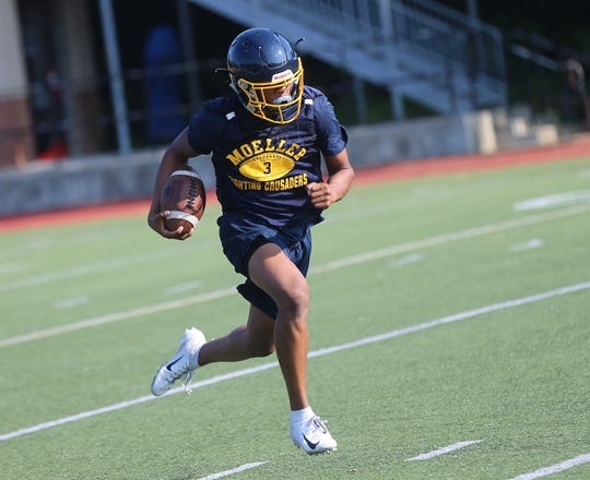 Moeller's Carrington Valentine runs the ball during the Crusaders' practice Thursday, Aug. 1, 2019.