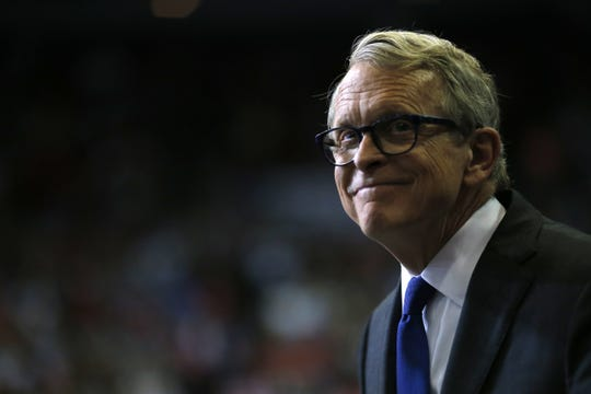 Ohio Governor Mike DeWine takes the stage to speak before President Donald Trump during a campaign rally at US Bank Arena in downtown Cincinnati on Thursday, Aug. 1, 2019.