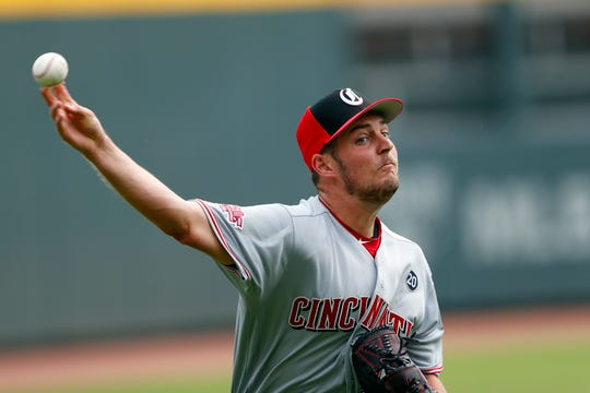Cincinnati Reds pitcher Trevor Bauer throws before the team's baseball game against the Atlanta Braves on Thursday, Aug. 1, 2019, in Atlanta.