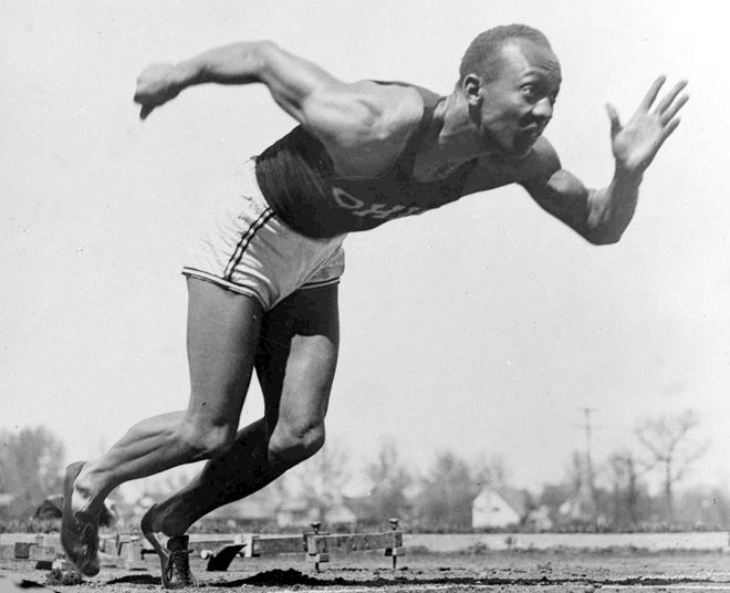 In this Aug. 5, 1936 file photo, American athlete Jesse Owens practices in the Olympic Village in Berlin.