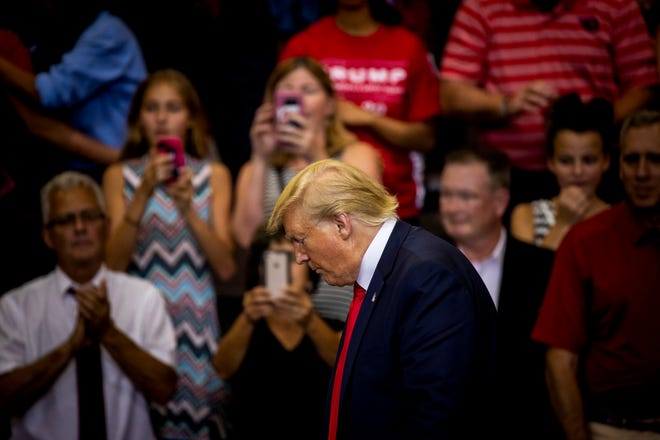 """President Donald Trump addresses the crowd at his """"Keep America Great"""" campaign rally Thursday, August 1, 2019 at U.S. Bank Arena in downtown Cincinnati."""