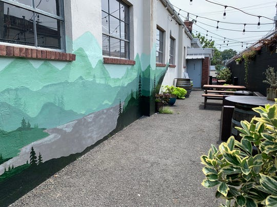 Two Ton Brewing's outdoor space, featuring a new mural.