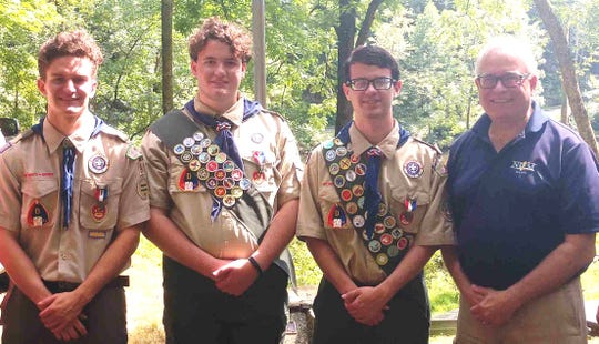 Jack Lukie, Zachary O'Connor and Scott Oshman with South Amboy Mayor Fred Henry celebrate their Eagle Scout awards at Camp Dill in Clinton Township.