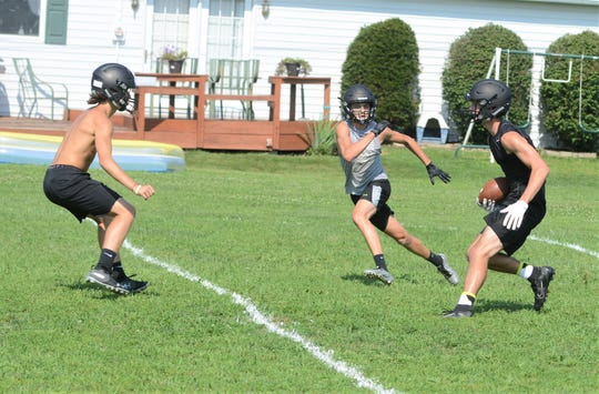 Ridgewood players run through receiving drills during a practice earlier this month. The Generals hit the road in the season opener, taking on West Salem Northwestern at 7 p.m. Friday.