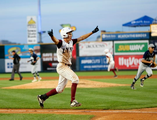 Jake Hilmer of North Linn celebrates as he runs home breaking a 0-0 tie in the 6th inning of the 2A state tournament semifinal Thursday, Aug. 1, 2019.