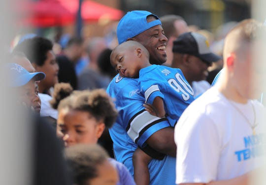 Fans enter the Detroit Lions practice during Family Fest, Friday, August 2, 2019 at Ford Field.