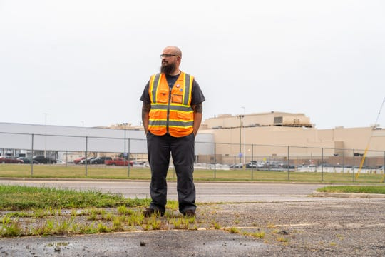 General Motors Flint Assembly material driver Sean Crawford of Flushing stands near the plant in Flint on Monday, July 29, 2019.