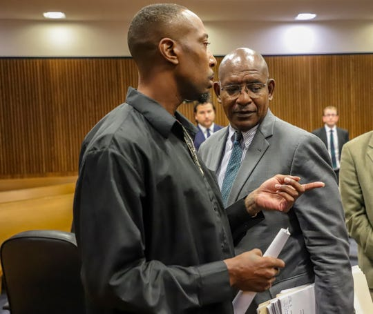 Defendant James Chad-Lewis Clay talks with his attorney, Melvin Houston, during a hearing Friday, Aug. 2, 2019 in Frank Murphy Hall of Justice in Detroit.