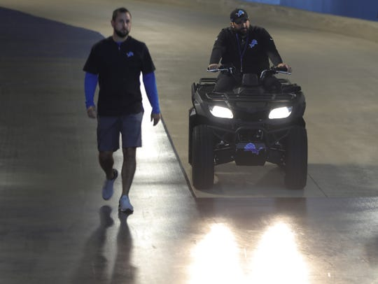Lions head coach Matt Patricia rides his ATV down the Ford Field tunnel with Kevin Anderson, his chief of staff, by his side.