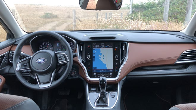 Subaru's DriverFocus uses an infrared camera hidden behind the dark space  above the navigation display.