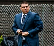 In this May 13, 2019, file photo, New York City police officer Daniel Pantaleo leaves his house in Staten Island, N.Y.