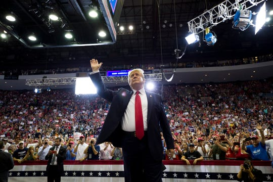 President Donald Trump waves to supporters before speaking at a campaign rally Thursday, Aug. 1, 2019, in Cincinnati.