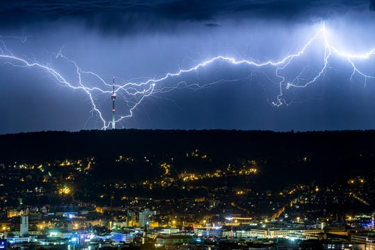 Lightning over the city of Stuttgart, southern Germany, as the heat wave in large parts of Europe gives way to storms and heavy rain.