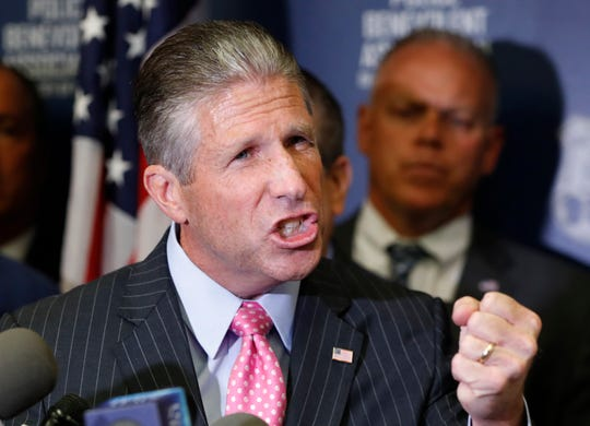 Patrick J. Lynch, president of the Patrolmen's Benevolent Association of the City of New York, gestures while speaks during a press conference regarding New York City police officer Daniel Pantaleo, Friday, Aug. 2, 2019, in New York. An administrative judge on Friday recommended firing Pantaleo, a New York City police officer accused of using a chokehold in the 2014 death of Eric Garner. The department suspended Pantaleo from duty shortly after the judge's decision.