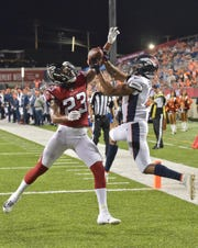 Denver Broncos wide receiver Trinity Benson (2) can't catch a pass under pressure from Atlanta Falcons defensive back Jayson Stanley (23) during the second half of the Pro Football Hall of Fame game Thursday. The Broncos won 14-10.