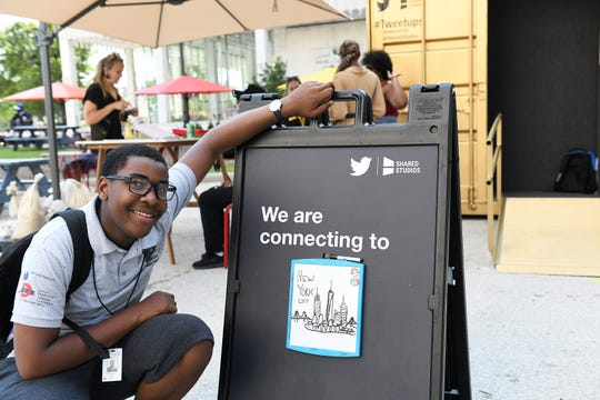 Connor White, 15, of Redford poses with the drawing he did of New York, the next destination for the conversation at the Shared Studio in Detroit on Aug. 2, 2019.