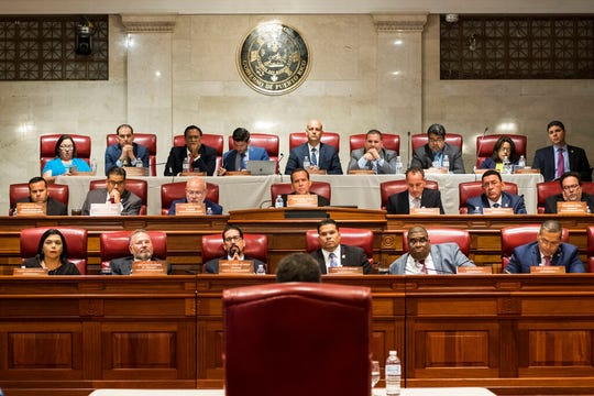 Proposed Secretary of State Pedro Pierluisi (back to camera) speaks during his confirmation hearing at the House of Representatives, in San Juan, Puerto Rico, Friday, August 2, 2019.