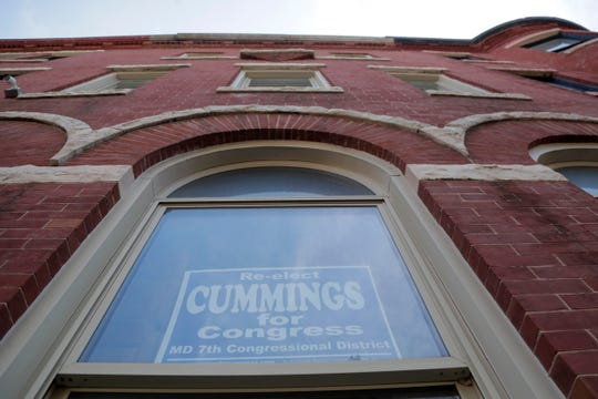 An election sign is seen on the window of U.S. Rep. Elijah Cummings, D-Md., Friday, Aug. 2, 2019, in Baltimore. Cummings says he scared off an intruder at his Baltimore home last weekend, providing details for the first time after President Donald Trump tweeted about the break-in.