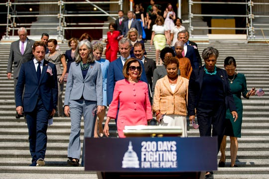 In this July 25, 2019, photo, House Speaker Nancy Pelosi of Calif., and House Democrats arrive for a news conference on the first 200 days of the 116th Congress at the House East Front steps of the Capitol in Washington. Nearly half the House Democrats now support an impeachment inquiry of President Donald Trump in the aftermath of Robert Mueller's testimony to Congress.