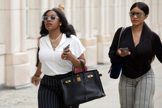 Azriel Clary, left, and Joycelyn Savage, right, two women who lived in Chicago with R&B singer R. Kelly, arrive at Brooklyn federal court for his arraignment, Friday, Aug. 2, 2019 in New York.