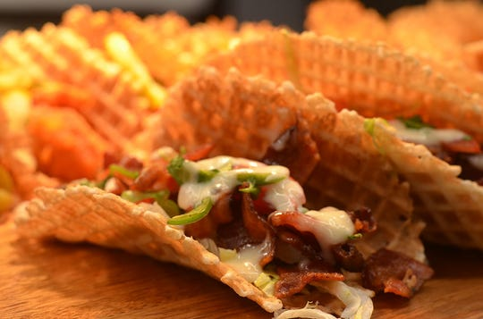 Waffle tacos, available only in the club levels, are served in a pair of two tacos. The first is a peppered bacon BLT, the second a Nashville hot chicken.