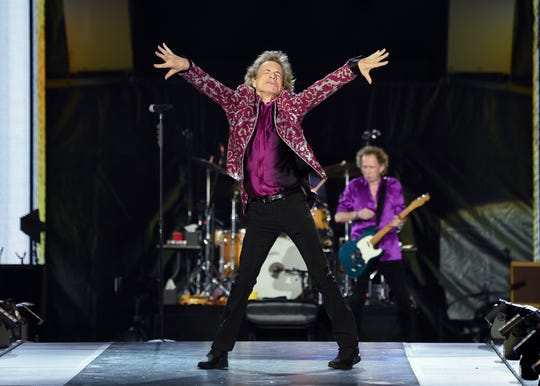 Musicians Mick Jagger, left, and Keith Richards of The Rolling Stones perform at MetLife Stadium on Thursday, Aug.1, 2019, in East Rutherford, N.J.