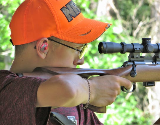 Kevin Wilcox, a member of Troy Junior Sportsmen, takes aim at a target with a .22-caliber rifle during the NRA's Youth Hunter Education Challenge Eastern Regional Championship at the Chemung County Rod & Gun Club.