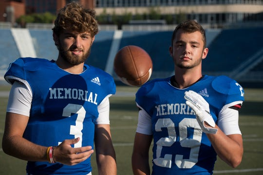 Memorial High School teammates Colton Pence (3) and Finn McCool (29) Friday, July 23, 2019.