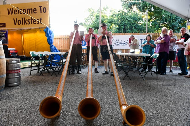 Alphorn players, left to right, Mark Steffenhagen, Charles Haas and Dan Schultz play at the keg-tapping kick-off for the 2019 Volksfest kicks-off at the Germania Maennerchor Thursday evening. August 1, 2019.