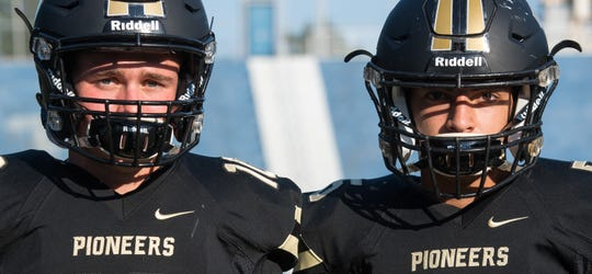 Boonville High School teammates Jackson Phillips (10) and Devin Mockobee (5) Friday, July 23, 2019.