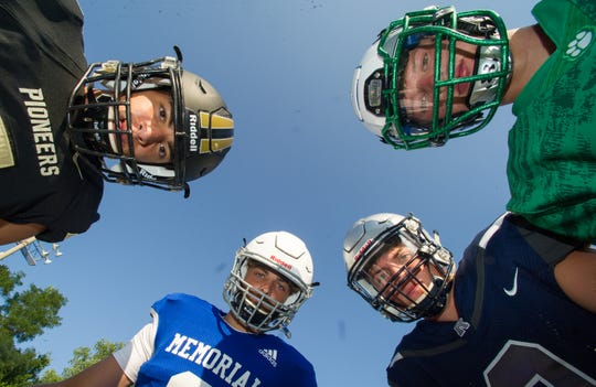 Left to right, Devin Mockobee (5) Boonville, Colton Pence (3) Memorial, Reid Brickey (2) Reitz, and Dyan McKinney (21) North Friday, July 23, 2019.