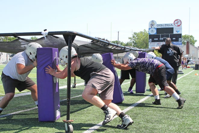 Coach Michael Rankins runs a drill for the lineman. Fremont Ross' footballl team had their opening day of practice for the 2019 season on August 1st.
