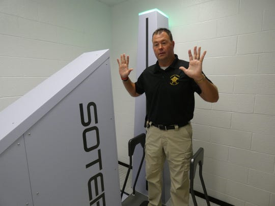 Sandusky County Sheriff Chris Hilton demonstrates new body scanner at the Sandusky County Jail.