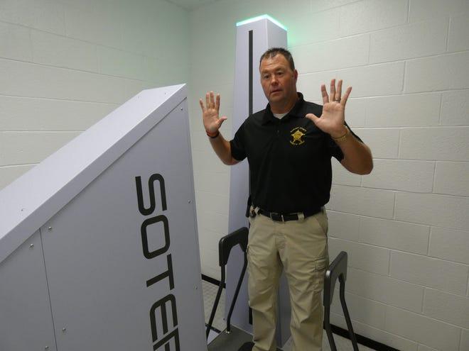 Sandusky County Sheriff Chris Hilton demonstrates new body scanner at the Sandusky County Jail.