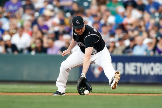 Colorado Rockies first baseman Daniel Murphy fields a ground ball during a July 29, 2019, game against the Los Angeles Dodgers at Coors Field in Denver. The Rockies begin a six-game road trip with a game at 6:10 p.m. Tuesday at the Houston Astros.