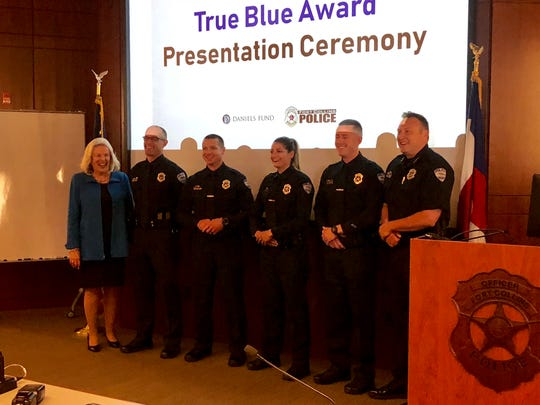The four Fort Collins officers were honored with the True Blue Award Thursday with Daniels Fund CEO Linda Childear and Chief Jeff Swoboda.