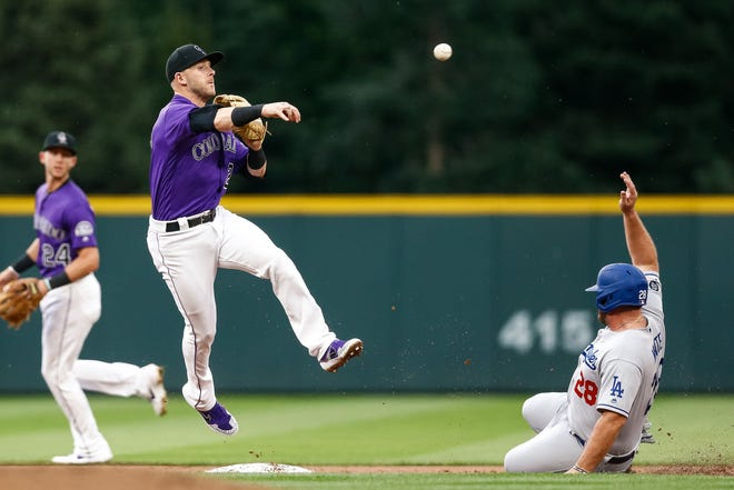 Colorado Rockies shortstop Trevor Story attempts to turn a double play in a July 30, 2019, game against the Los Angeles Dodgers at Coors Field in Denver. The Rockies wrap up a three-game weekend series with the San Francisco Giants with a 1:10 p.m. game Sunday at Coors Field.