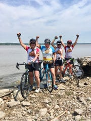 Linda Pope, Lisa Duggan, Ellie Pope and Julie VanLaanen celebrate reaching the Mississippi River in Montrose, Iowa.