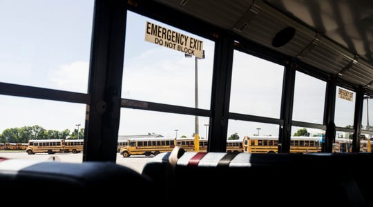 School busses sit at the bus barn on Daniels Parkway recently. The school year is about to get underway and the school district is asking parents, kids and drivers to be aware and patient as the school year starts.