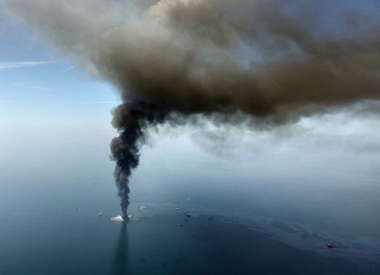 FILE - This April 21, 2010, file photo, shows a large plume of smoke rising from BP's Deepwater Horizon offshore oil rig in the Gulf of Mexico. Officials say more than $100 million from a settlement after the 2010 spill has been spent on restoring Texas coastal habitat.