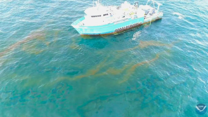 This September 2018 photo provided by NOAA shows a NOAA research vessel at a Taylor Energy production site in the Gulf of Mexico. A new federally led study of oil seeping from a platform toppled off Louisiana's coast 14½ years ago found releases lower than other recent estimates, but contradicts the well owner's assertions about the amount and source of oil.