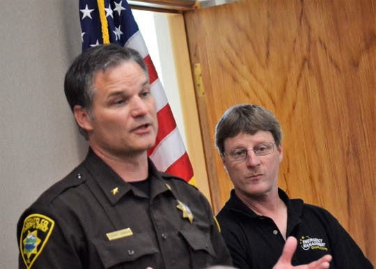 Oconto County Emergency Management Director Tim Magnin, right, listens as Sheriff Todd Skarban talks about response to the July 19 storm to members of the Oconto County Board at a special meeting Aug. 1.