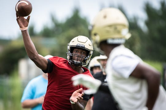 Raheim Jeter throws a pass as they practice plays on Greer's first day of football practice August 2, 2019.