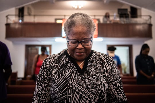 Elizabeth Anderson, 66, of Anderson prays with other members of the community at a prayer service at Royal Baptist Church in Anderson, Thursday, August 1, 2019, which Rev. Emanuel Flemming Sr. organized to address the gun violence the city has been struggling with.