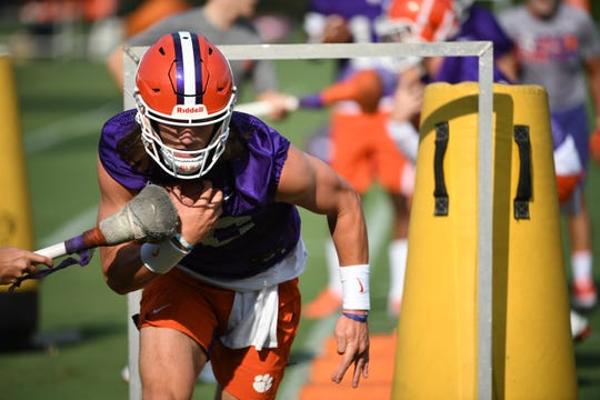 Clemson quarterback Trevor Lawrence goes through drills during the opening day of preseason practices on Friday, August 2, 2019.